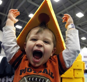 William Grimsley models a cheesehead for his father, J.D., while souvenir shopping Wednesday, February 2, 2011 at the NFL Experience at the Dallas Convention Center in Dallas, Texas. The events features interactive games; collectibles, souvenirs and football exhibits. He is from Dallas. MARK HOFFMAN/MHOFFMAN@JOURNALSENTINEL.COM